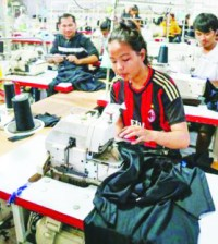 garment-factory-workers-produce-items-of-apparel-at-a-warehouse-in-kandal-province-last-year.-heng-chivoan