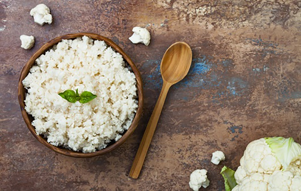 Cauliflower rice in a bowl. Top view, overhead, copy space