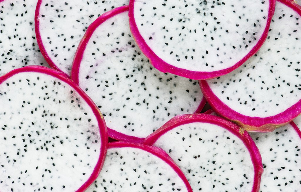 Closeup of dragon fruit slices background