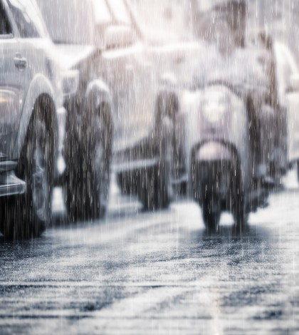 Hard rain fall in the city with blurry cars .Selective focus and